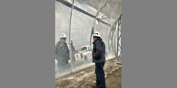 Division staff takes a closer look at Enel's reflective solar panels that are used increase the temperature of pumped geothermal water at their Stillwater plant near Fallon, NV. (01/2020)